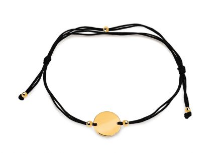 Gold bracelet with black cord and plate
