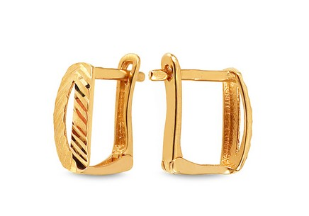 Gold hoop earrings with engraver