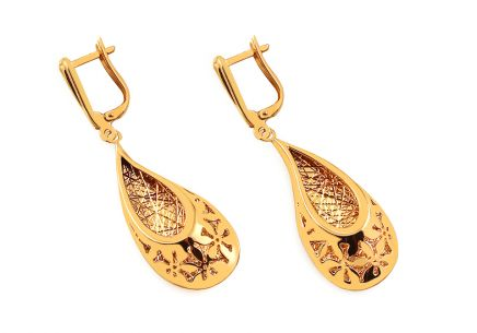 Golden earrings with carved pattern