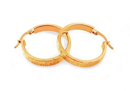 Gold hoop earrings with engraving