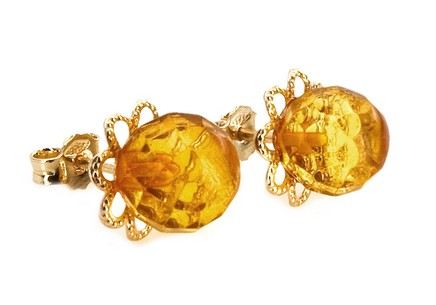 Gold stud earrings with amber flower