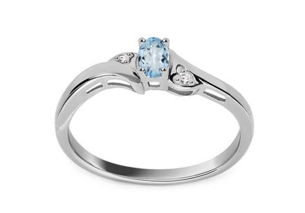 White gold engagement ring with topaz and 0.010 ct diamonds