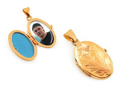 Gold oval medallion for photo with floral engraving