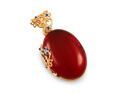 Golden plated pendant with cherry amber and blue stones