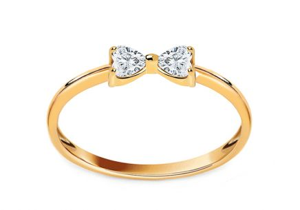 Gold ribbon ring with zircons
