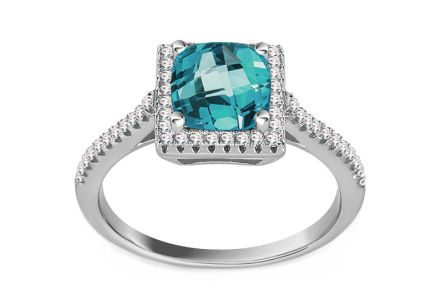 Silver ring with blue and clear zircons